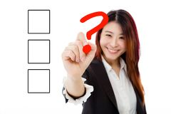 Chinese businesswoman filling in checkbox on virtual screen. Asian businesswoman deciding on checkbox on virtual screen Royalty Free Stock Image