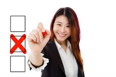 Chinese businesswoman filling in checkbox on virtual screen Royalty Free Stock Image