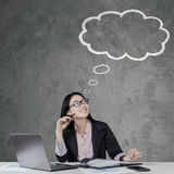 Chinese businesswoman looking at a cloud tag Stock Photography
