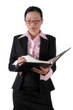 Chinese businesswoman with notebook. Chinese businesswoman, wearing lady's suit and shirt. Holding documents, reviewing documents Stock Photos