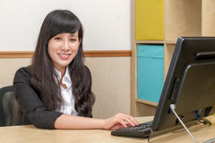 Chinese businesswoman in office at desk Royalty Free Stock Image