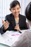 Chinese businesswoman talking to her client Stock Photo