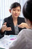 Chinese businesswoman talking to her client Royalty Free Stock Images