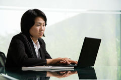 Chinese businesswoman at work Stock Image