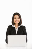 Chinese Businesswoman Working On Laptop Royalty Free Stock Image