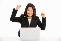 Chinese Businesswoman Working On Laptop And Celeb Royalty Free Stock Image