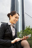 Chinese Businesswoman Working On Tablet Computer Stock Photos