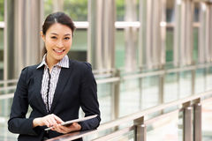 Chinese Businesswoman Working On Tablet Computer Royalty Free Stock Images