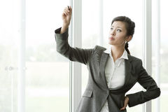 Chinese Businesswoman Writing on Copy-space Royalty Free Stock Images