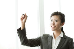 Chinese Businesswoman Writing on Copy-space Royalty Free Stock Photos