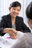 Chinese busineswoman handshake with her client Stock Images