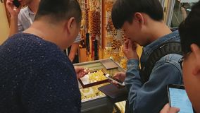 Chinese buyers are traded for amber and jewelry stock video footage