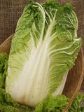 Chinese cabbage. With leaves of salad in a basket on a sacking Royalty Free Stock Photos