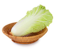Chinese cabbage on basket over white. Stock Photos