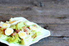 Chinese cabbage salad with canned tuna and quail eggs dressing with olive oil and lemon juice Stock Photos