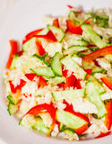 Chinese cabbage salad with red bell pepper and cucumber Stock Photo