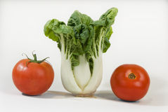 Chinese cabbage and tomato  on a white background Royalty Free Stock Images