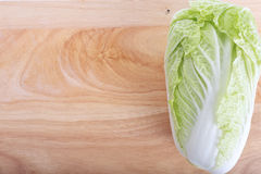 Chinese cabbage on wooden chopping board Stock Photo