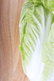 Chinese cabbage on wooden chopping board Royalty Free Stock Image