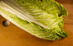 Chinese cabbage on a wooden kitchen board Stock Photography