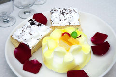 Chinese Cakes. Elegantly crafted Chinese cakes decorated with frosting and fruits Royalty Free Stock Image