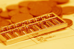 Chinese calculator and coin. With golden ton royalty free stock image