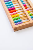 Chinese calculator with colorful beads - Close-up. Concept photo Royalty Free Stock Image