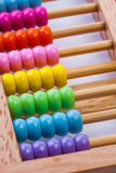 Chinese calculator with colorful beads - Close-up. Concept photo Stock Photos