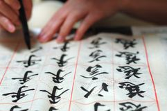 Chinese Calligraphy. It is a Chinese girl on writing Chinese calligraphy Stock Photography