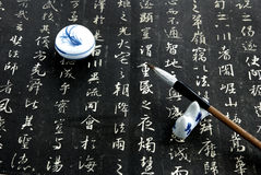 Chinese calligraphy on black Stock Photos