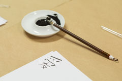 Chinese calligraphy. Black ink and brush for chinese calligraphy Stock Images