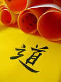 Chinese calligraphy. On golden paper Royalty Free Stock Photo