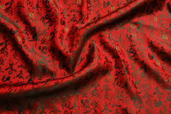 chinese Calligraphy silk.Chinese style. red silk background. Royalty Free Stock Image