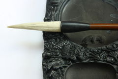 Chinese calligraphy tool——brush and inkstone. Chinese calligraphy tool——brush and dragon art carving inkstone Stock Photography