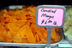 Chinese Candy Store. Candied Mango in Window on Sale with Price Sign Royalty Free Stock Photography
