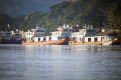Chinese cargo boats in Mekong river , Thailand Stock Photos