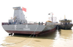 Chinese cargo ship in Yangtze. River with red flag on it.The picture was taken in a port in Wuhan which lies  in central China,Time is:Oct.10,2010 Royalty Free Stock Photography