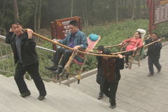 Chinese carry the palanquin in a park in Zhangjiajie Royalty Free Stock Photos