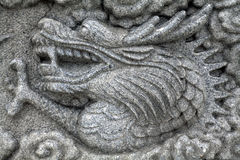 Chinese carved rocks. With dragons and flowers Royalty Free Stock Photography