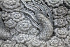 Chinese carved rocks. With dragons and flowers Royalty Free Stock Photo