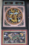 Chinese Carved Wooden Panels. Malacca - December 2011 Carved wooden panels depicting the qi lin and phoenix outside a shophouse in Malacca's Jonker Street royalty free stock photography