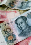 Chinese Cash. Chinses ten yuan bill on top of a pile of Chinese cash Royalty Free Stock Photography