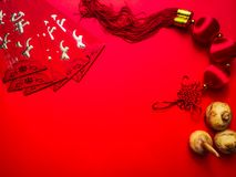 Chinese cash envelope and knots on red background for Chinese New Year stock photos