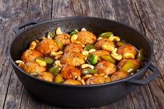 Chinese Cashew Chicken meatballs  in saucepan Stock Photos