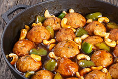 Chinese Cashew Chicken meatballs  in saucepan Stock Images