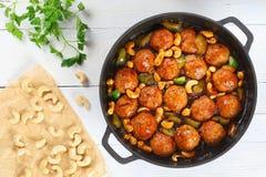Chinese Cashew Chicken meatballs in saucepan stock photo
