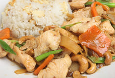 Chinese Cashew Chicken with Rice. Chinese takeaway meal of chicken with cashew nuts and egg-fried rice stock image