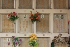Traditional chinese graves in cemetery in Singapore. Chinese cemetery in Singapore. Each grave contains the cremated remain of one person. Chinese writing and Royalty Free Stock Images