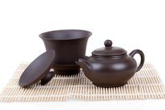 Chinese ceramic tea set bamboo mat isolated on white Royalty Free Stock Photo
