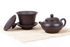 Chinese ceramic tea set bamboo mat isolated on white Stock Image